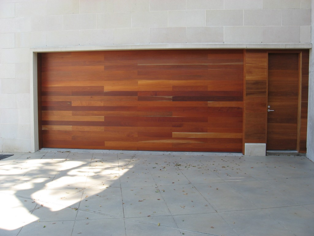 768 #753C28 See How Overhead Door Company Makes Custom Wood Clad Doors picture/photo Garage Doors Custom 36691024