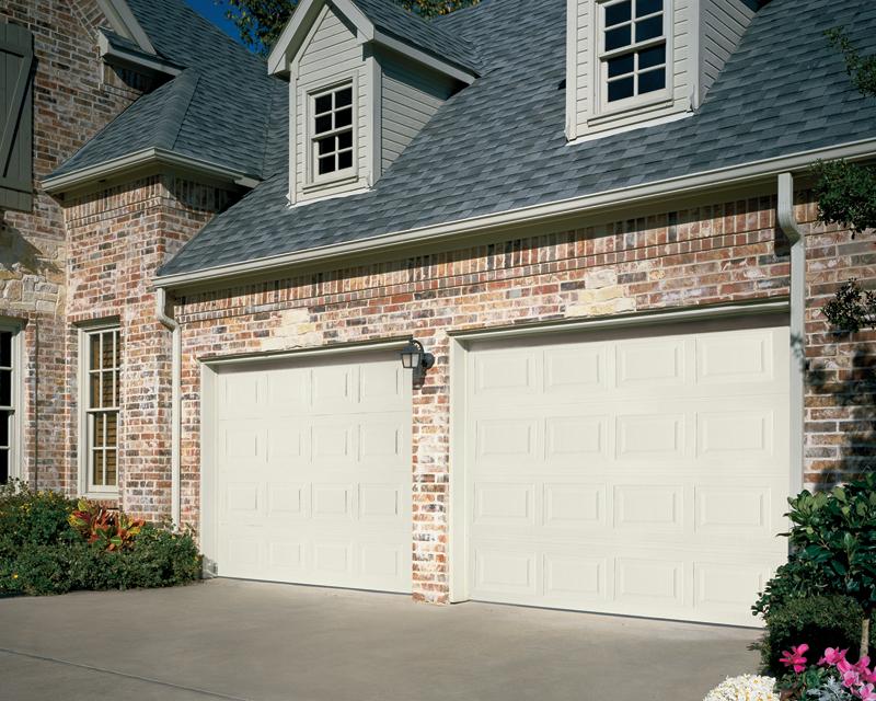 Traditional steel doors overhead door company of houston for Odyssey 1000 garage door opener price