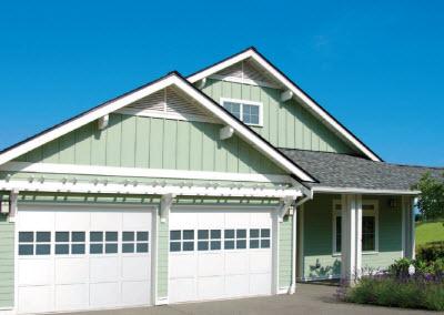See How Overhead Door Company Makes Custom Wood Clad Doors
